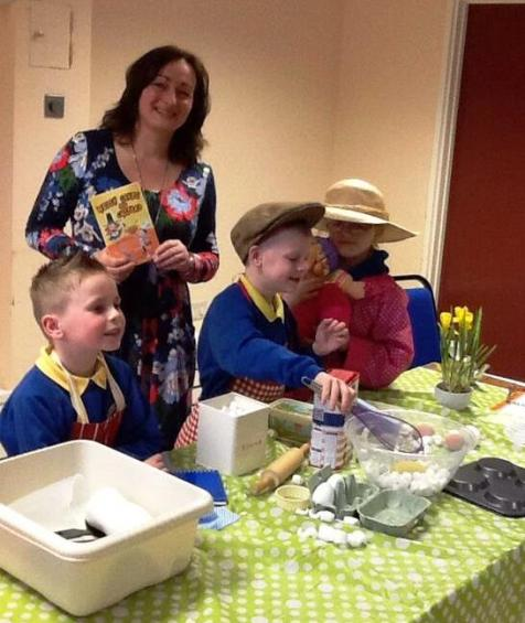 Richmond Park School children dressed as Emyr Rhys, Da-cu and Nain making Welsh cakes