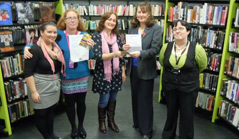 Wendy presenting awards to competition winners at Llanelli Library