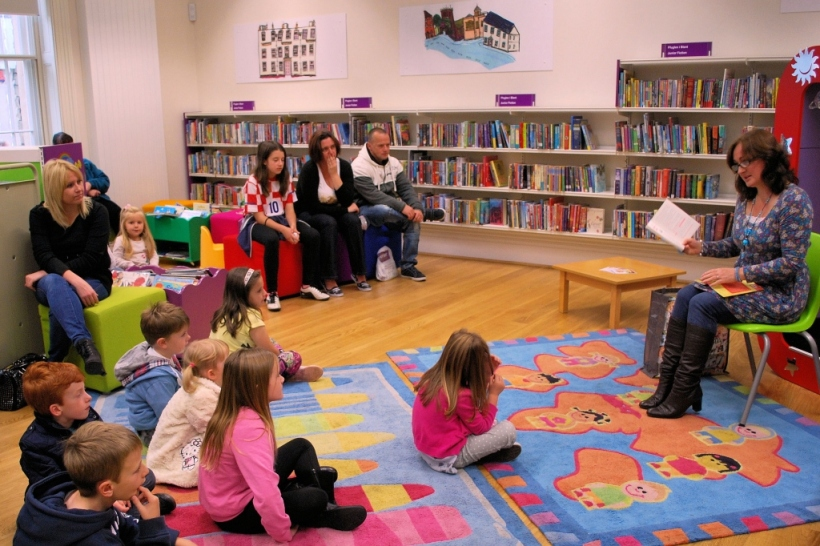 Wendy reading to children at Llanelli Town Library