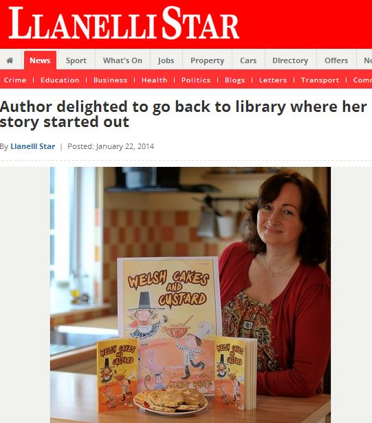 Wendy with poster and copies of Welsh Caked and Custard - picture taken from article in the Llanelli Star