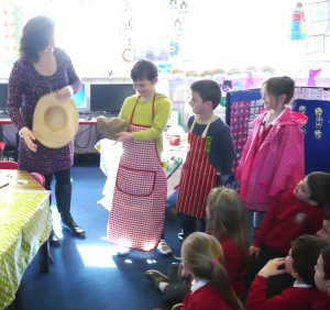 Primary school children preparing for role-play