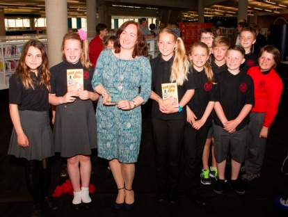 Wendy with children from St Andrew's School at,Cardiff Central Library